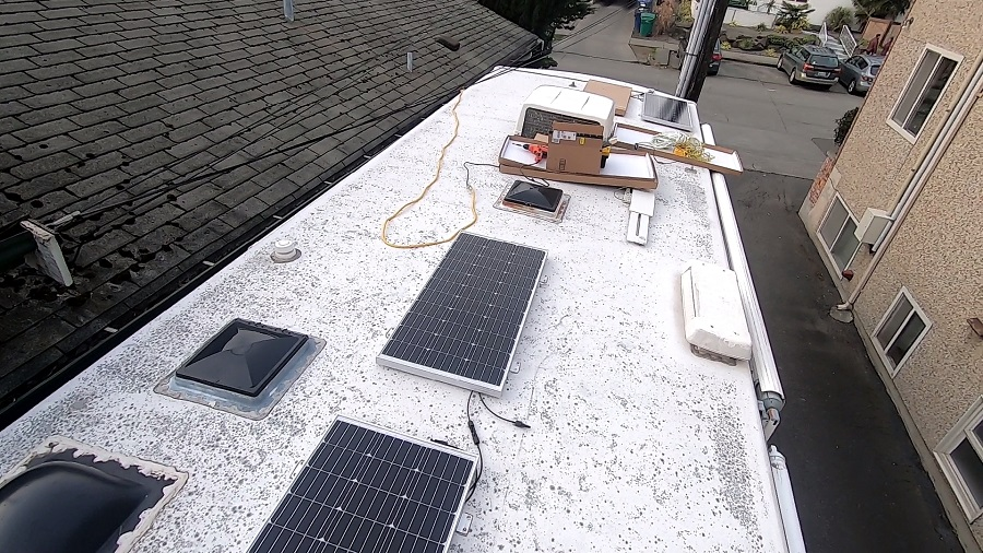 Solar panels being installed on an RV roof